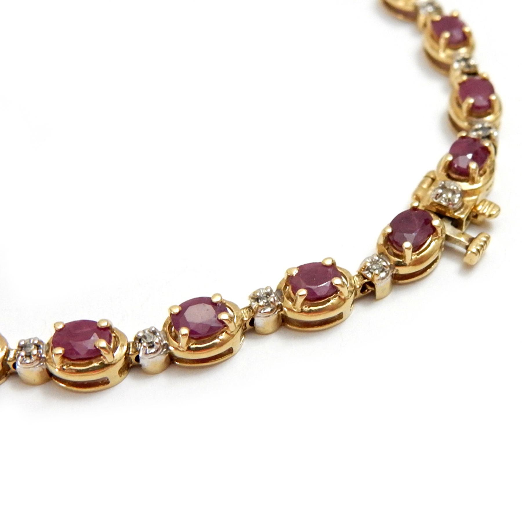 14k gold link bracelet with ruby and diamond accents from