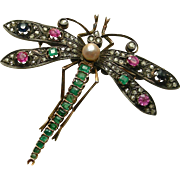 An Art Nouveau 18K French Dragonfly Brooch Set With Emeralds, Diamonds, Sapphires, Rubies, & A Pearl Circa 1910