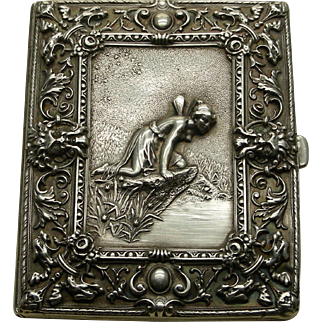 A Sterling Repousse Cigarette Case With Winged Fairy, North Wind Figures, And Griffins. Signed Wm. Kerr.