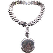 A Sterling Victorian Large Engraved Locket With Matching Collar