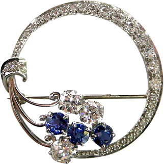 A 1940s Platinum Diamond & Sapphires Crescent Brooch
