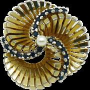 PENNINO Sapphire Blue Rhinestone Pinwheel Brooch Gold Plated Rhodium