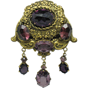 Circa 1930 ART DECO Repousse Brass Amethyst Crystal Dangle Dress Clip