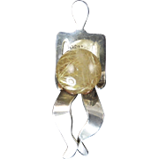 Modernist Sterling Stick Pin of a Figure Holding a Rutilated Quartz Orb