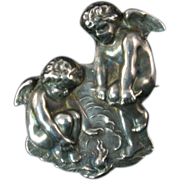 Unger Brothers Brooch with a Pair of Cherubs