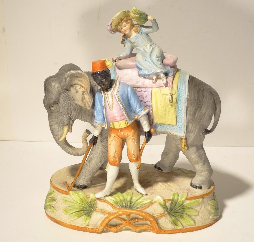 Girl Riding an Elephant c1910 Bisque Porcelain Group by Kister Germany