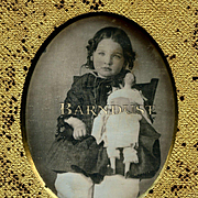 1850s Daguerreotype of Little Girl Holding Large China or Papier Mache Doll, Light Tinting