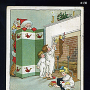 1910s R. Tuck Postcard Santa Peeks at Children Discovering Toys in Stockings, MBH illust. #198