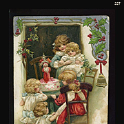 1912 Winsch, Children in Awe Over Santa Doll, Holly, Embossed Christmas Postcard #227