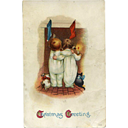 c1910s Christmas Postcard, Cat, Dog Sit by Children, Everyone Stares at Fireplace, Wait for Santa As IS #253