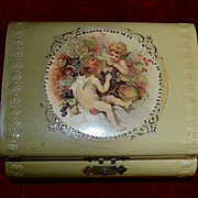 Small Celluloid Covered Box with Cherubs, Pink Interior