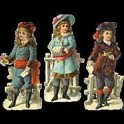 """Winter Children, Three 6"""" Victorian Die Cuts"""