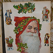 Huge Victorian Die Cut Santa Head, Wears Red Hood & Holly Wreath, Smaller Santas on Large Scrapbook Page