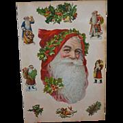 Huge Victorian Die Cut Santa Head, Wears Red Hood & Holly Wreath, Smaller Santas on Large Scrapbook Page