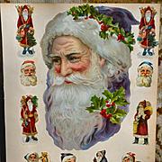 Huge Victorian Die Cut Santa Head, Wears Lavender & Fur with Holly Wreath, Smaller Santas on Large Scrapbook Page
