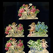 7 Victorian Die Cut Valentine Cupids Carrying Flowers in Car, Bicycle, Wheelbarrow