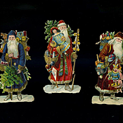 "3 Small Victorian Die Cut Santa Claus Figures About 3-1/4"" tall"