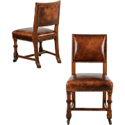 Pair of Antique English Leather Chairs w/ Carved Oak c. 1900
