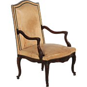 French Rococo Revival Leather Arm Chair of Carved Mahogany, 19th century