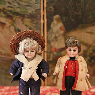 Two lovely All Bisque Boys in original Clothing
