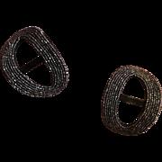 A pair of Late Georgian/early Victorian cut steel bead buckles