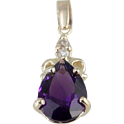 The Amethyst Sabrina Pendant By Market Square Jewelers, Lovely Scrolling 14K Yellow Gold Necklace Drop set with Deep Purple Stone