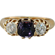 Beautiful Rare Color Change Garnet in 14K Gold Setting, Three Stone Style With Diamonds