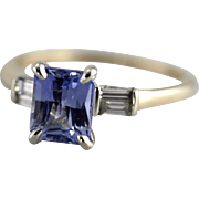 Rare Blue Sapphire with Sophisticated Rectangular Faceting and Diamond Anniversary Ring