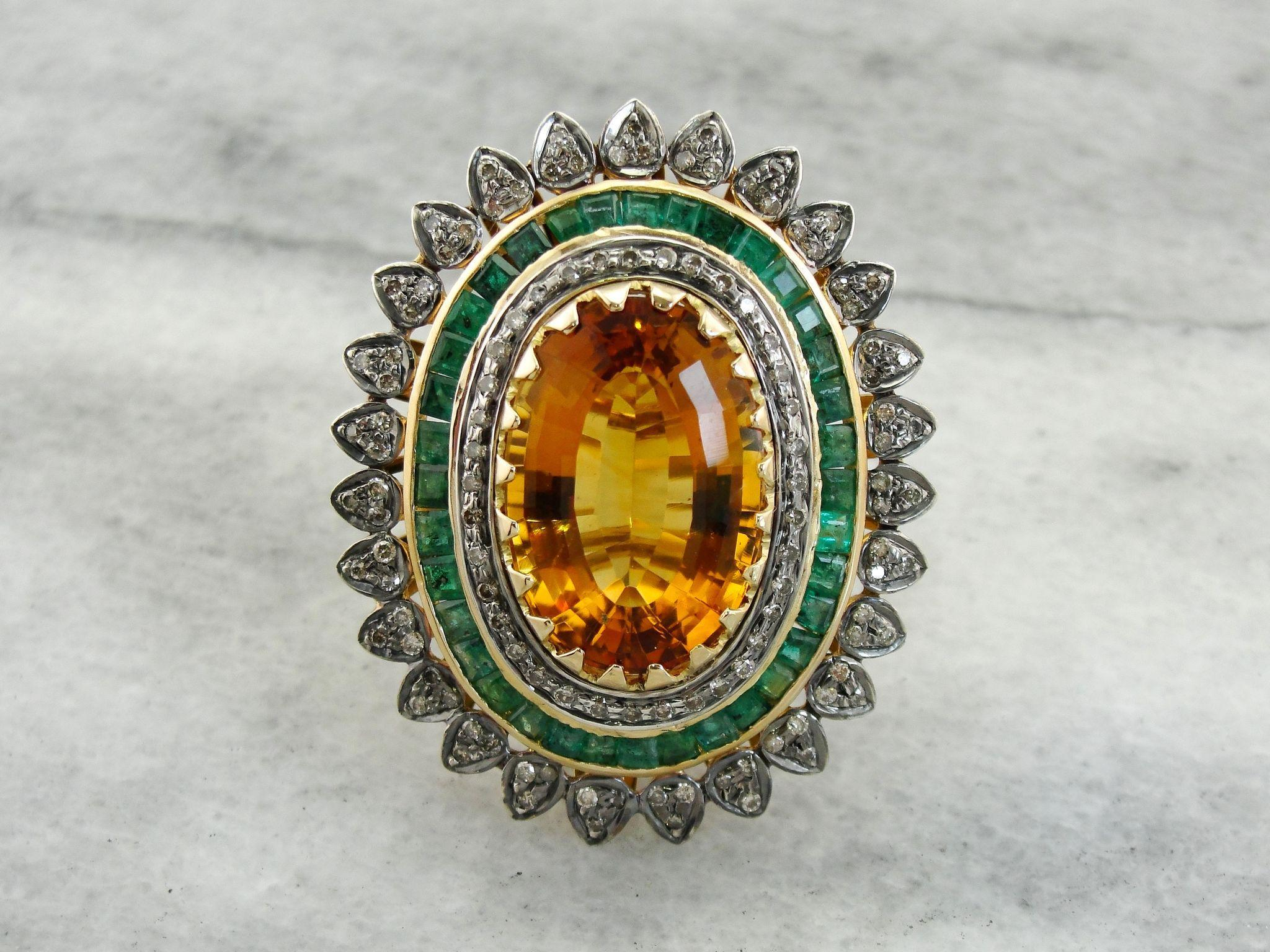 jaw dropping citrine and emerald statement ring