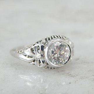 Feminine and Luxurious Filigree Engagement Ring with Fine Diamond