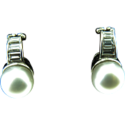 18k White Gold 11mm South Sea Pearl Earrings with Approx. 1.50cttw Baguette Diamond Accents.