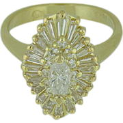 18K Yellow Gold Diamond Cluster Ring with Marquis Center, Tapered Baguettes, and Round Brilliant Cuts.  Approx. 1.50cttw.