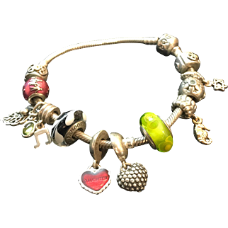 Sterling silver Pandora bracelet with 12 charms