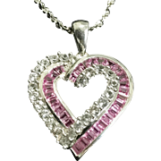 10K white gold Pink and white cz heart pendant on a 30 inch sterling silver twisted chain