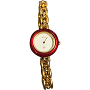 Ladies Gucci vintage 18 k Gold Plated Watch With 6 interchangeable color bezels.