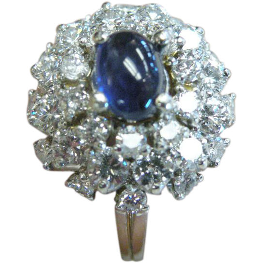 Platinum Diamond Cluster Ring With Round Cabochon Cut Sapphire.