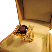 Eight Carat Garnet Solitaire Ring in 14 Karat Gold