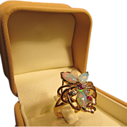 Beautiful Opal Ring in 14 Karat Gold with Accenting Rubies and Diamonds