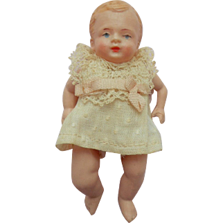 Chubby Little Celluloid Doll In Lovely Clothing c1930