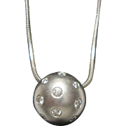Stunning Etienne Perret Platinum and Diamond Pendant.