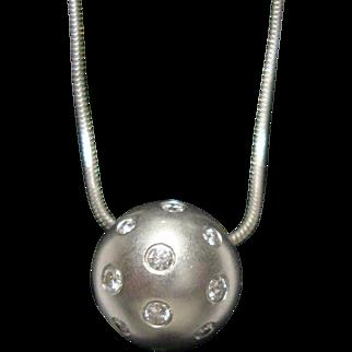 Stunning Etienne Perret Platinum and Diamond Pendant.
