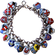Silver Charm Bracelet with Enamel Charms.