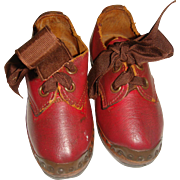 Super old pair of red childrens clogs