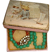 Small French box with jewellry for doll