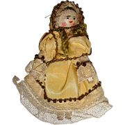 Cute old miniature wooden doll well dressed