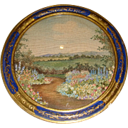 Circular embroidered painted picture charming