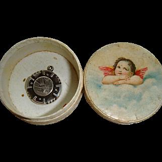 Tiny silver pendant in cherub box