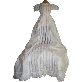 Beautiful early christening gown with many lace inserts and lace front