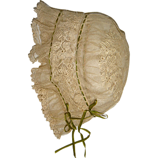 Early lace bonnet with butterfly on back