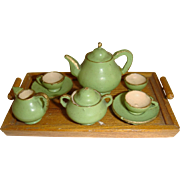 Green wooden tea set on tray